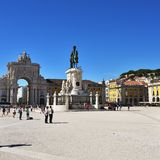 Commerce Square in Lisbon, Portugal. Lisbon, Portugal - June 11, 2017 : Praca do Comercio Commerce Square, Rua Augusta Arch and  equestrian statue of King Jose I Royalty Free Stock Image