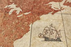 Galleon arriving America engraved on the floor. Lisbon, Portugal- May 30, 2018: Galleon arriving America engraved on the floor of the monument of the discoveries Stock Photo