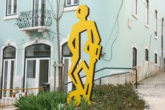 Lisbon, Portugal 01 may 2018: Monument football player or creative street art on the theme of football on the city stock images