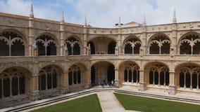 Cloister of Jeronimos Monastery in Lisbon, Portugal. Lisbon, Portugal - May 11, 2017: People in the cloister of Jeronimos Monastery. Since 1983, the monastery is stock footage