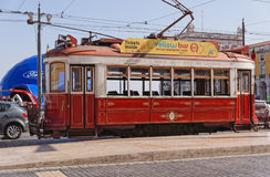 Lisbon, Portugal - May 14: Traditional the red tourist tram in Lisbon on May 14, 2014. Since the early 1900s, the trams have been Stock Photos