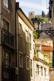 Lisbon, Portugal: narrow street with view to the castle Royalty Free Stock Photos