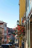Narrow and colorful street of Lisbon Stock Images