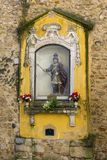 Niche with an image of St. George at the entrance of the castle of the same name. LISBON, PORTUGAL - NOVEMBER 21, 2018: niche with an image of St. George at the royalty free stock photo