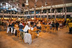People eat at TimeOut Market in Lisbon, Portugal. LISBON, PORTUGAL - OCT 30, 2018, 2018: People eat at TimeOut Market in Lisbon, Portugal. TimeOut Market is a royalty free stock photography