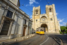 Lisbon, Portugal. Old tram in front of cathedral in Lisbon, Portugal Royalty Free Stock Images