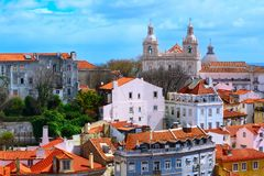 Lisbon, Portugal view with Estrela Basilica. Lisbon, Portugal panoramic aerial view with colorful houses and Estrela Basilica cathedral towers royalty free stock photography