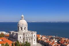 Lisbon, Portugal. Panteao Nacional aka Igreja de Santa Engracia Church. Alfama District rooftops and Tagus River Estuary. The National Pantheon is a 17th Stock Photography