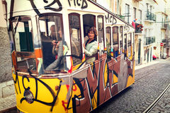 Lisbon, Portugal, 2016 05 09 - people in yellow tram - elevador Royalty Free Stock Photos