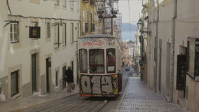 LISBON, PORTUGAL - SEP 15, 2015: Famous retro designed funicular in the Old Town street of Lisbon, Portugal. Professional shot on DSLR fith high dynamic range stock video footage