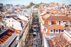 Lisbon city in Portugal. LISBON, PORTUGAL - September 27, 2017: Aerial view on the crowded with people central street in Lisbon city, Portugal royalty free stock photo