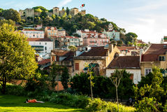 Lisbon, Portugal - Septmember 19, 2016: Park below the viewpoint of Graca, castle on the horizon Royalty Free Stock Photo