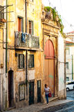 Lisbon, Portugal - Septmember 19, 2016: Street scene in old neighbourhood Mouraria Royalty Free Stock Photo