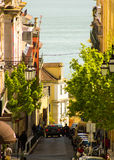 Lisbon, Portugal: Serpa Pinto street, downtown, with view to Tagus river Royalty Free Stock Photos