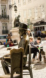 Lisbon, Portugal: Two statues of two poets: Pessoa and Chiado Royalty Free Stock Photography
