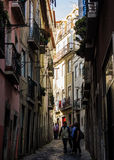 Lisbon, Portugal: typical street of the old quarter of Alfama Royalty Free Stock Photo