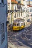 LISBON, PORTUGALIA †'Marzec, 28, 2014: Sławny żółty tramwaj 28 Fotografia Royalty Free