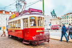 Typical tram in the center of Lisbon in Praca da Figueira. LISBON, PT - MAR 3, 2018: A typical tram in the center of Lisbon runs along Praca da Figueira during royalty free stock photography