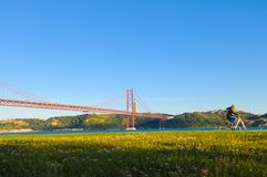 Lisbon Red Suspension Bridge, Outdoor Exercise, Travel Portugal Royalty Free Stock Photo