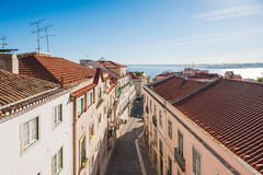 Lisbon roofs and street aerial view against blue sky Stock Images