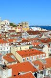Lisbon Rooftops. Panorama of old traditional city of Lisbon with red roofs and view of river Tagus Stock Images