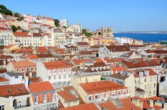 Lisbon Rooftops. Panorama of old traditional city of Lisbon with red roofs and view of river Tagus Stock Photos