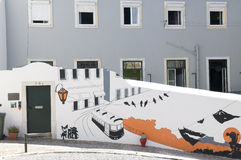Lisbon s Building and a Mural with Typical Tram Royalty Free Stock Photo