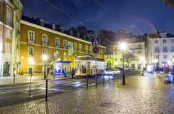 Lisbon's Historic Quarter with Cable Car by Night Stock Photography