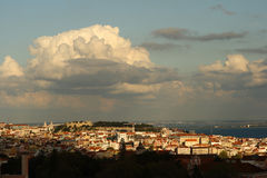 Lisbon skyline. View over Lisbon (Portugal), the old part of the town with the old castle. The sky is blue with heavy clouds Stock Photo