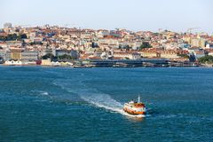 Lisbon skyline on the Tagus River, excursion boat tour, Portugal.  royalty free stock photos