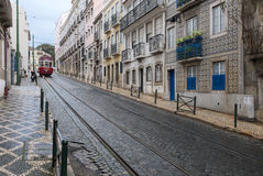 Lisbon street with red tram Stock Photo