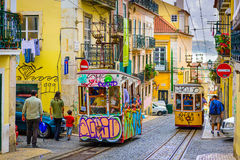 Lisbon Street Scene. LISBON, PORTUGAL - SEPTEMBER 12, 2014: Pedestrians and trams in Lisbon. The historic trams are a popular attraction Royalty Free Stock Image
