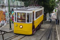 Lisbon street with the typical yellow tram.  stock photo