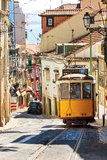 Lisbon street yellow tram Stock Photos