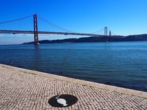 Lisbon 25th april bridge on a sunny day royalty free stock images