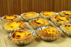 Lisbon tradicional pastries. Traditional portugese egg tarts - pastries pasteis de nata in tin moulds Stock Photography