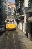 Lisbon tram. Famous yellow tram in the narrow Lisbon street Royalty Free Stock Image