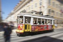 Lisbon tram. Traditional yellow tram on sloping street, Lisbon city, Portugal Royalty Free Stock Photo