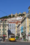 Lisbon tram. Two of the most representative symbols of Lisbon (Portugal): Sao Jorge castle and the tram n. 38. Always crowed by people from Lisbon and tourists! Royalty Free Stock Image