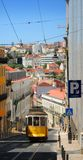 Lisbon tram. Traditional yellow tram on sloping street, Lisbon city, Portugal stock photo