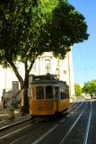 Lisbon tram car. Yellow tram and urban landscape of Lisbon, Portugal royalty free stock images