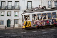 LISBON tram electrico journey 28. LISBON, PORTUGAL - DECEMBER 7, 2017 - The 28 Lisbon yellow tram connects Martim Moniz with Campo Ourique, through the popular stock image