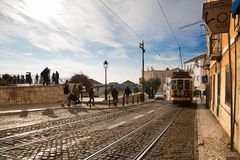 LISBON tram electrico journey 28. LISBON, PORTUGAL - DECEMBER 7, 2017 - The 28 Lisbon yellow tram connects Martim Moniz with Campo Ourique, through the popular stock photos