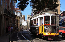 Lisbon tram riding on the streets Stock Photos