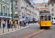 Lisbon tram. Rossio square. LISBON, PORTUGAL - NOVEMBER 23: Yellow tram number 12 goes by the street of Lisbon city center on November 23, 2013. Lisbon is a Stock Photography