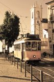 Lisbon tram in the sepia style and church Royalty Free Stock Images