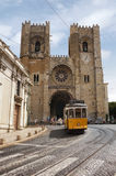 Lisbon. Yellow tram No. 28. Cathedral of Lisbon in Romance style Stock Image