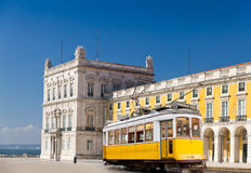 Lisbon yellow tram at Praca de Comercio, Portugal. Historic classic yellow tram of Lisbon built partially of wood in front of Lisbons central square Praca de Royalty Free Stock Photos