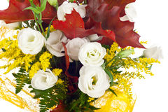 Lisianthus and autumn leaves Royalty Free Stock Photography