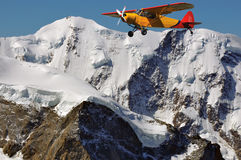 Liskamm and old plane. The dangerous high summit for climbers of Liskamm with sight seeing airplane passing close by Stock Photos